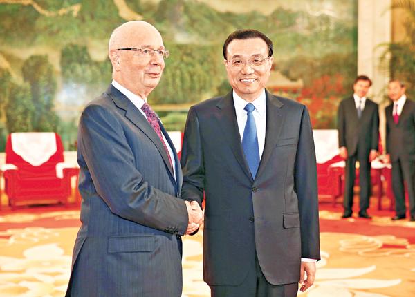 ■李克強昨日在天津會見世界經濟論壇主席施瓦布。中新社