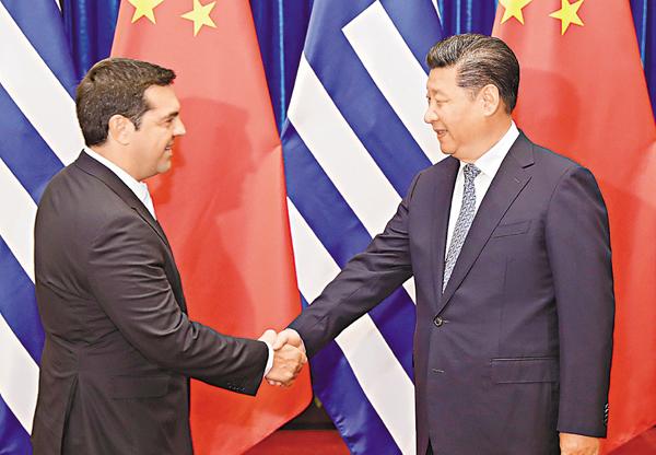 ■習近平昨日在北京人民大會堂會見希臘總理齊普拉斯。 中新社