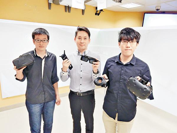 ■電子計算學系專任導師吳曉峰(中)及兩名該校博士學生。 黎忞  攝