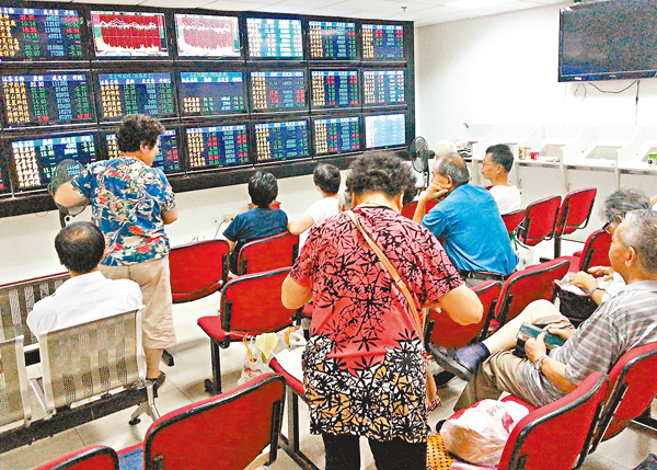 ■調研顯示,機構投資者信心指數已止跌企穩,散戶信心指數亦現回暖。 倪巍晨 攝