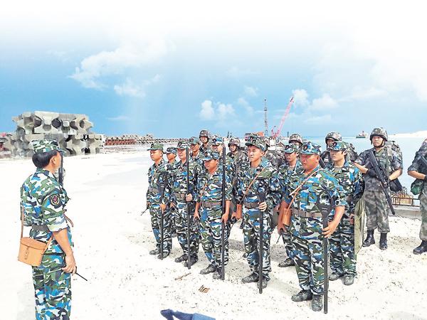 ■三沙民兵準備巡島。記者楊帆  攝