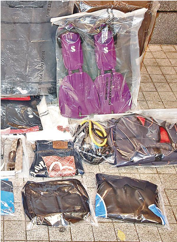 ■警方指疑犯涉及本年9月至10月間9宗於機場巴士上偷竊行李案,失物總值17.4萬元。 資料圖片