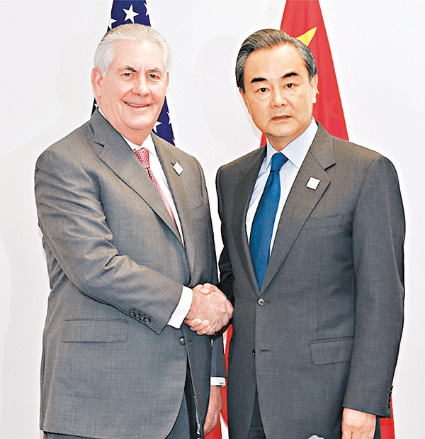 ■中國外交部長王毅會見美國國務卿蒂勒森。新華社