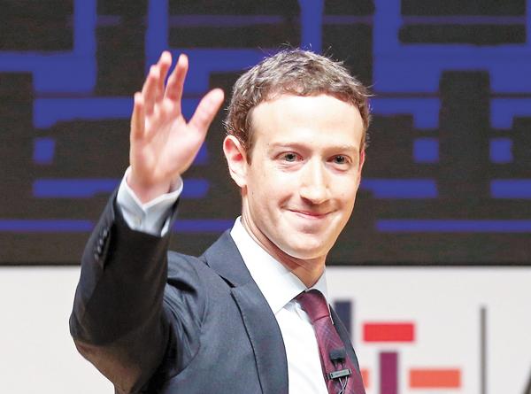 ■朱克伯格希望帶領fb,由聯繫朋友及家人的平台,進化到團結全球民眾的社群。美聯社