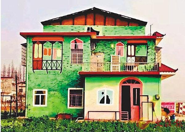 ■南縣羅文村的民居塗鴉。本報湖南傳真