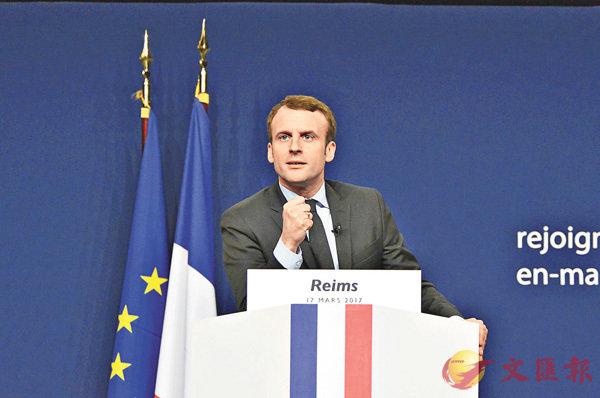 ■圖為民調輕微領先的馬克龍在法國蘭斯舉行的一次競選集會上。中新社
