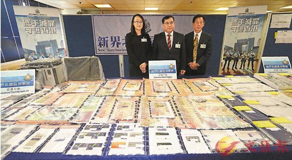 ■行動檢獲現金、電腦、電話、身份證影印本及提款卡。香港文匯報記者劉友光 攝