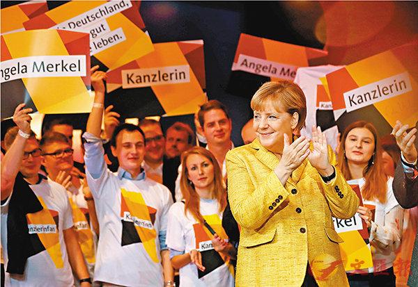■默克爾在柏林作最後衝刺,呼籲支持者投票。 路透社