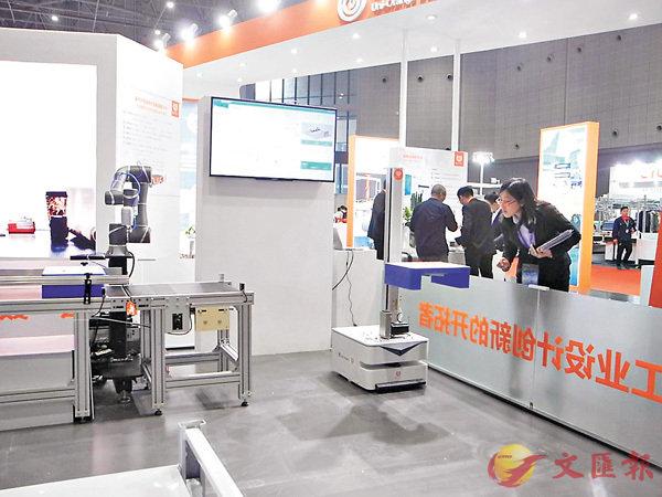 ■「橙色雲」首創全球協同研發系統,大大提高研發效率,圖為「橙色雲」在上海工博會上的展台。
