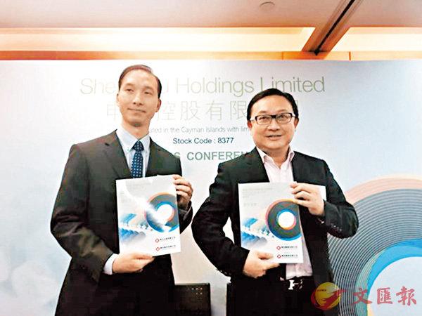 ■黃國偉(右)預計今年全年仍未能扭虧。旁為申酉控股財務總監兼執行董事李永康。