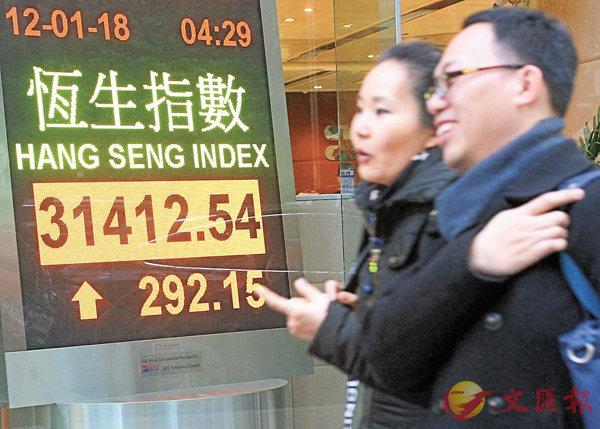 ■港股連升14日,距離歷史高位不足600點。中新社