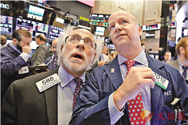 ■美股交易員密切留意市況。 美聯社