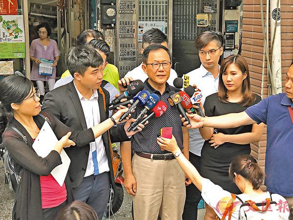 ■國民黨台北市長參選人丁守中(中)。中央社