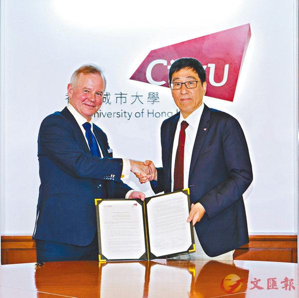 ■郭位(右)與Ottersen教授(左)於6月19日簽訂學術交流合作備忘錄。