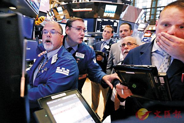 ■金融市場作為真實世界的一個經濟實驗室,其快速反應和交流,令人目不暇給。圖為紐約證券交易所的交易員。 美聯社