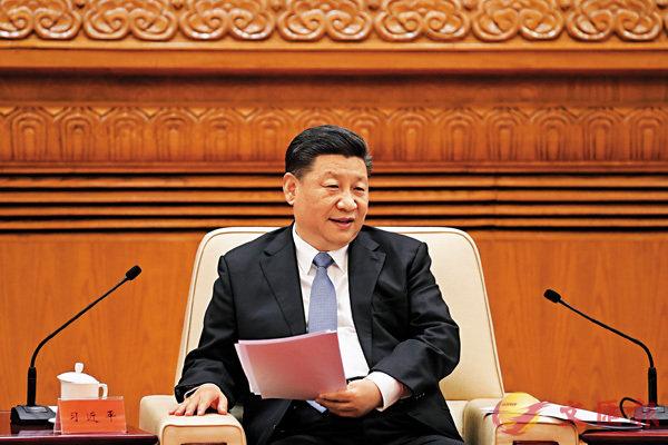 國家主席習近平日前在北京人民大會堂會見香港澳門各界慶祝國家改革開放40周年訪問團。 資料圖片