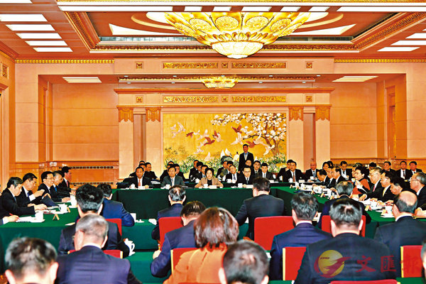 ■ 香港各商界代表認為,昨日通過的8項政策措施有助香港融入國家發展大局。圖為在北京舉行的灣區建設領導小組第二次全體會議會場。
