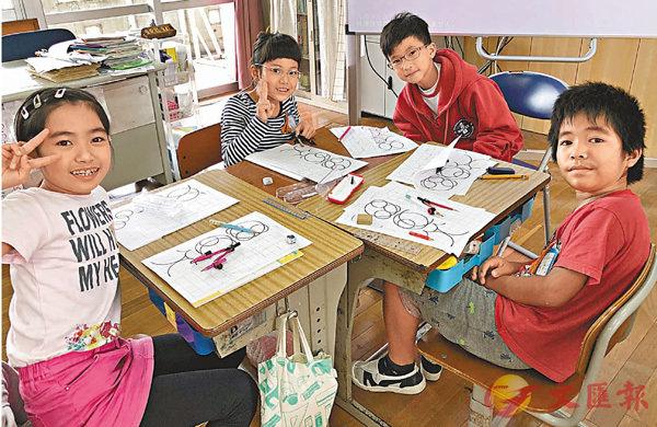 ■佛教黃藻森學校到沖繩交流,兩地同學衝破語言隔膜、打成一片。 學校供圖