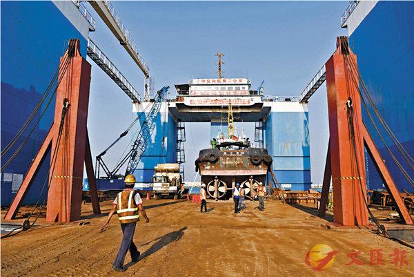 ■羅思義指「債務陷阱論」沒有任何理論基礎。圖為斯里蘭卡科倫坡港口城工地現場。新華社