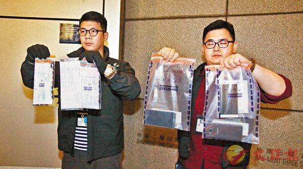 ■行動中檢獲的懷疑偽造買賣本票的收據和疑用作犯案的智能電話。 香港文匯報 記者 鄺福強  攝