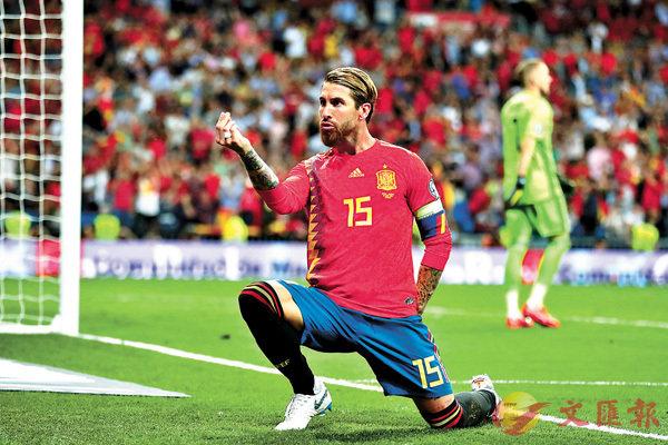 ■沙治奧拉莫斯幫助西班牙先拔頭籌。  美聯社