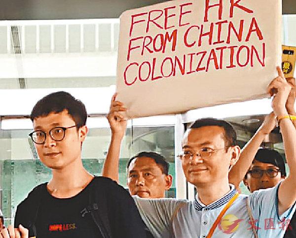 ■劉�鬖J(左)與曾焯文(右)於6月26日合辦「領事館馬拉松」。 資料圖片