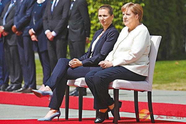 ■默克爾昨日在總理府接待到訪的丹麥新任首相弗雷澤里克森。 美聯社