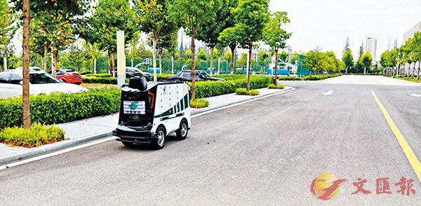 ■ 郵政智能無人投遞車在湖北仙桃市政府及直屬單位區域內行走。 網上圖片