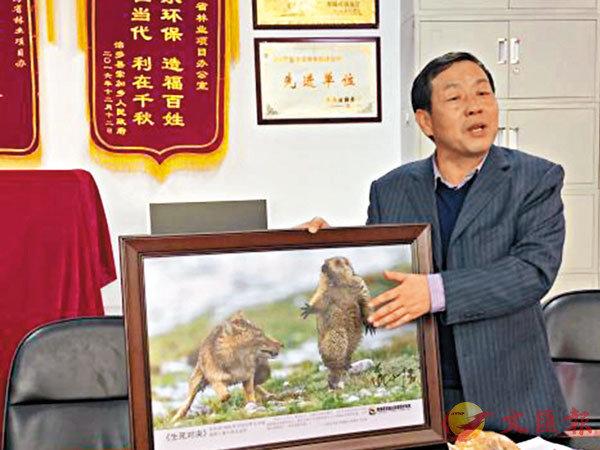 ■照片拍攝者中國攝影師鮑永清摘得年度野生動物攝影師大獎。 網上圖片