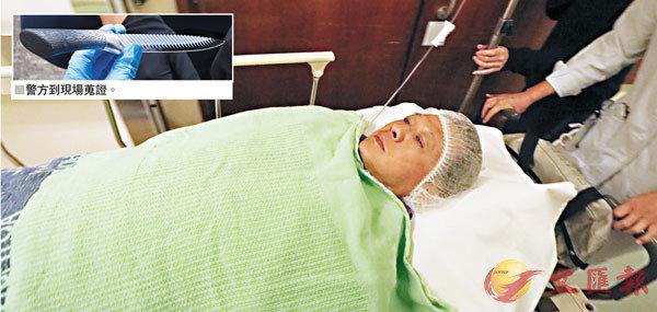■何君堯遇襲送院。 香港文匯報記者劉友光 攝