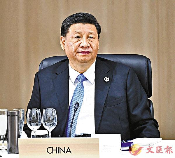 ■習近平今日將出席G20應對疫情視頻峰會。圖為習近平去年出席G20峰會。 資料圖片