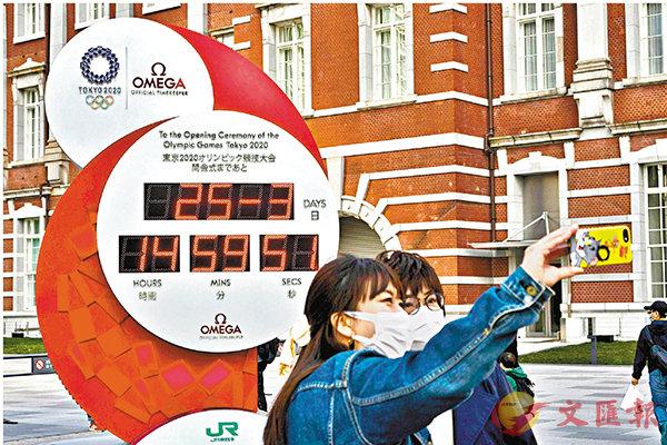 ■東京市內的奧運倒數板,暫時變為只顯示當天的日期與時間。  美聯社