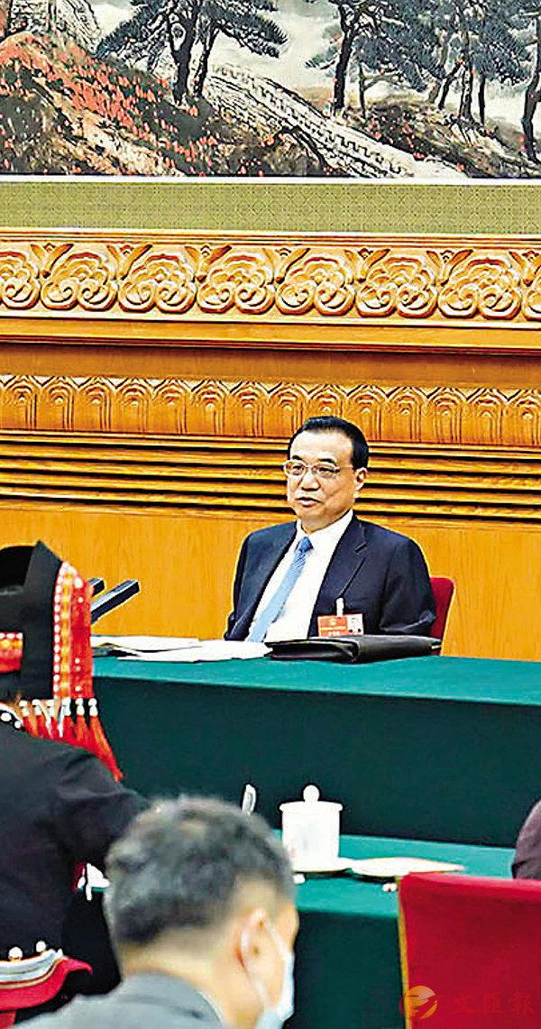 ■昨日,李克強參加十三屆全國人大三次會議廣西代表團的審議。 新華社