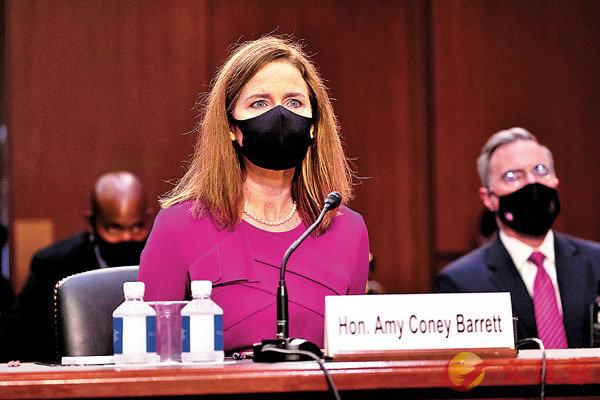 ■ 巴雷特戴口罩出席聽證會。 路透社