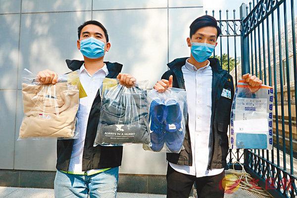 ●打傷「麥記」職員男子被捕,警方檢獲該男子犯案時穿�茠漲蝒咫巹A案手機。香港文匯報記者  攝