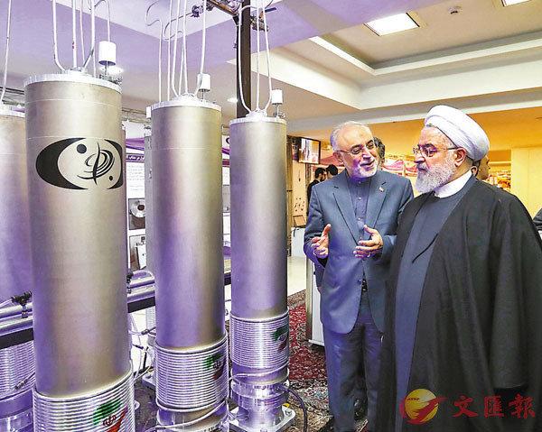 ● 伊朗在多番抗議後,前日宣布拒絕重返談判桌。圖為魯哈尼於2019年到訪當地核子研究設施。 資料圖片